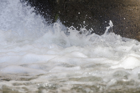 Beautiful Stop Action of a Outdoor River Rapids forming abstract foam forms