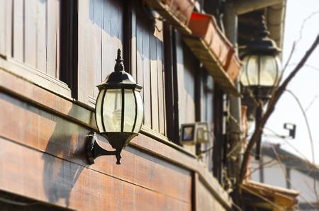 Old street lamp in traditional wooden balcony in Bansko, Bulgaria