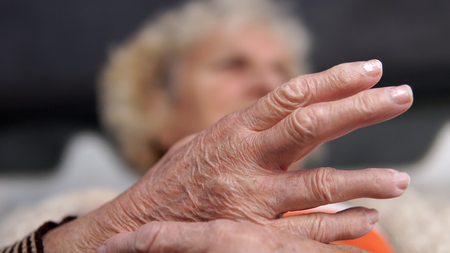Closeup Old Grandma Woman With Painful Hand. Health Care Concept