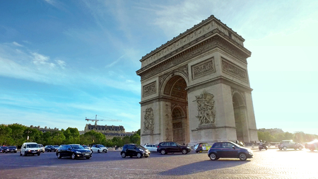 Paris, France - circa May, 2017: Traffic around the famous Arc du triomphe. Police block the way fro security reason, hyperlapse cinematic view