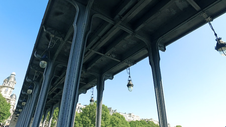 POV move under Pont De Bir-Hakeim, Pont De Passy Bridge in Paris, France Фото со стока