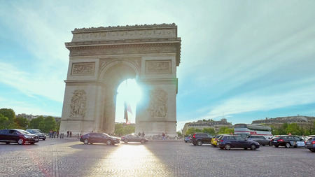 Paris, France - circa May, 2017: Car traffic on Champs-elysees in front of Arc de triumph in Paris, France, cinematic steadicam movement