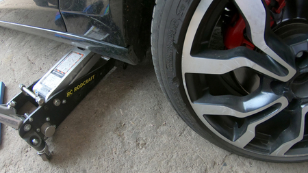 Kocani, Macedonia - 24 Jun, 2018: Low Section Of Male Mechanic Repairing Car's Tire In Repair Shop Редакционное