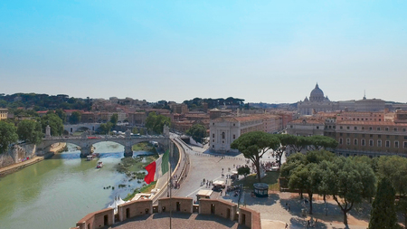 Panoramic view of St. Peter's Basilica and river with bridges from the terrace of Castel St. Angelo Фото со стока - 120404348