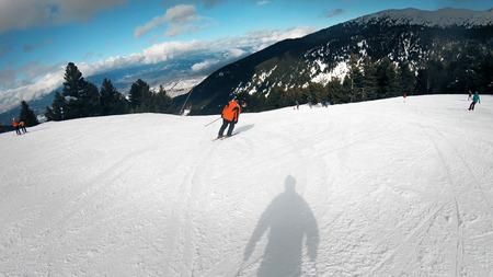 POV from helmet mount camera of amateur skier skiing down the Shiligarnik ski piste in Bansko, Bulgaria, a world ski cup resort Фото со стока - 120406044