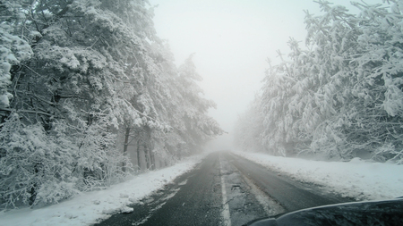 The car is driving on a winter road in a blizzard, POV Фото со стока - 120419656