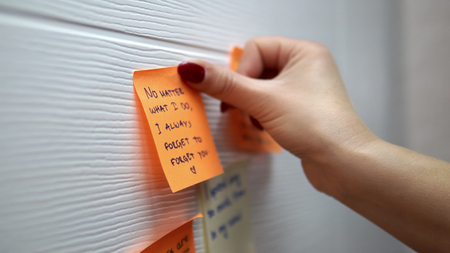 Adding a message sticker on board. Closeup of creative business team brainstorming ideas and concepts Фото со стока