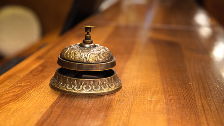 Tourists man and woman ring on a service bell in a hotel