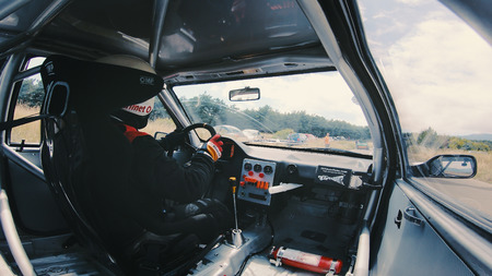 Kocani, Macedonia - 24 Jun, 2018: Racer With Helmet In Sport Car Before The Hillclimb Race Starting