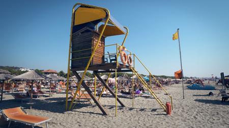 Durres, Albania - circa Aug, 2017: Life guard tower on luxury beach resort in Durres, Albania Publikacyjne