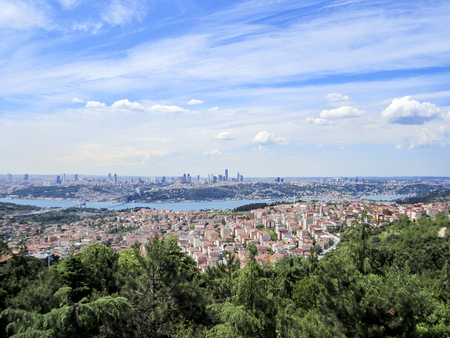 Istanbul aerial panorama with view of Bosporus Bridge and modern buildings district Фото со стока