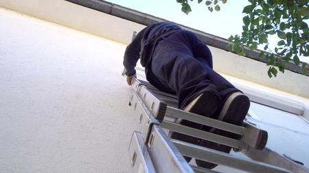 Male technician repairing, installing outdoor air conditioner unit