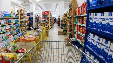 Skopje, Macedonia - circa Mar, 2018: Empty shopping cart trolley moving through supermarket Publikacyjne