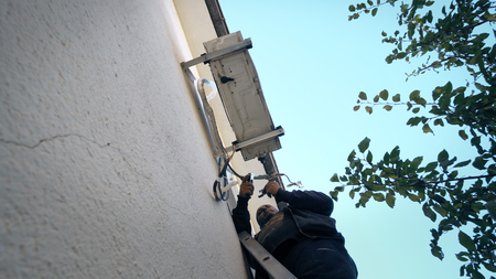 Repairman Works On Air Conditioner outdoor unit, cinematic shot Фото со стока - 120639175