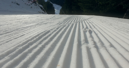 Snow lines made from a snow machine on a ski slope, cinematic steadicam shot Фото со стока - 120638355