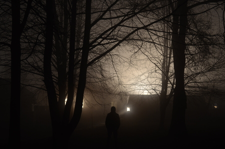 conflagration: Man at the scary forest at night