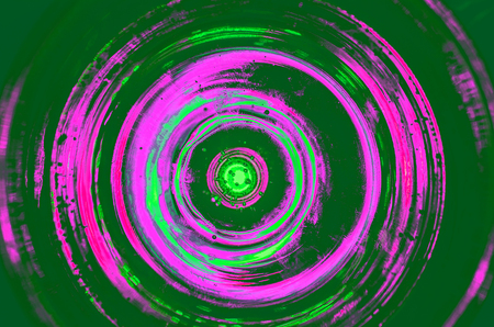 Hypnosis Spiral,concept for hypnosis, descending pattern, abstract background of scintillating circles white grey brown black green blue lime yellow orange maroon violet pink turquoise colored texture