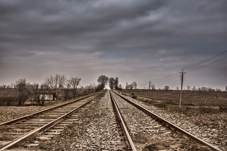 Rails (dormitories) at the electrified railway corridor. Cloudy weather. Gazakh Azerbaijan wintertime Stock Photo