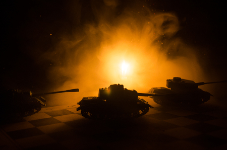 Three tanks in the conflict zone. The war in the countryside. Tank silhouette at night. Battle scene. War concept