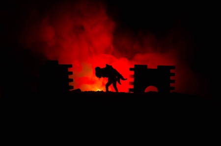 hands fire passion: a silhouette of a man holding on to the woman. Rescue saviour concept. Escape from fire or danger. Surreal decoration