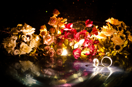 bunch of hearts: Wedding card, Wedding rings. Wedding bouquet, background. Flowering branch with white delicate flowers on wooden surface. Declaration of love, spring. Dark background with smoke and heart. Love conept