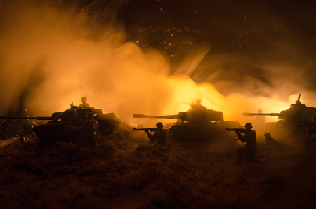 War Concept. Military silhouettes fighting scene on war fog sky background, World War Soldiers Silhouettes Below Cloudy Skyline At night. Attack scene. Armored vehicles. Tanks battle