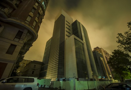 Night view of the city of Baku. Street buildings at night time. Downtown of the capital of Azerbaijan Stock Photo