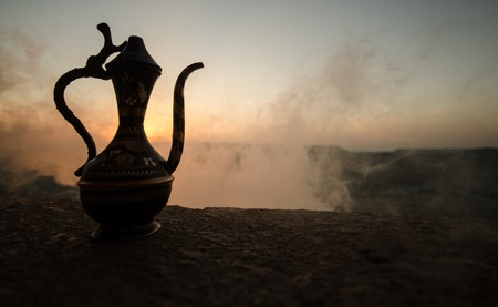 Decorative Arabian Vase And Jug Pictured At Sunset With Fog Stock