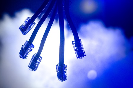 Network switch and lan cables, symbol of global communications. Colored network cables on dark background with lights and smoke. Selective focus. Network internet concept background