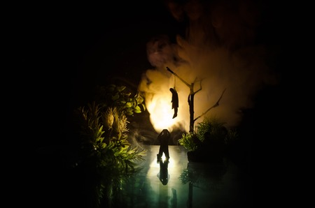 Horror view of hanged girl on tree at evening (at night) Suicide decoration. Death punishment executions or suicide abstract idea. Different background decoration Stock Photo