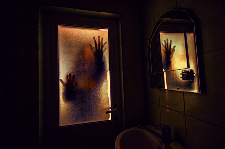 Horror woman in window wood hand hold cage scary scene halloween concept