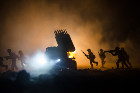 Rocket launch with fire clouds. Battle scene with rocket Missiles with Warhead Aimed at Gloomy Sky at night. Soldiers and Rockets War Backgound. Selective focus Stock Photo