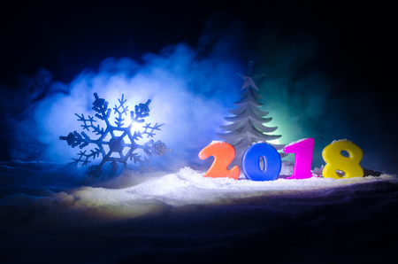 New Years Eve celebration background with new year elements or symbols. Decoration for greeting card. Happy new year. With dark background. Selective focus