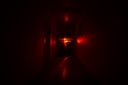 Dark corridor with cabinet doors and freezelight figures on it. Horror Concept.