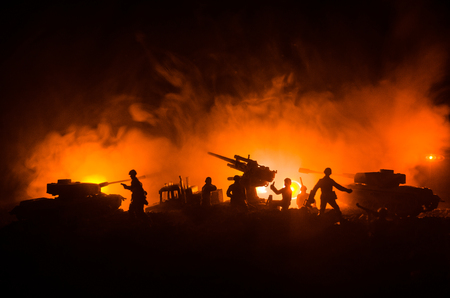 An anti-aircraft cannon and Military silhouettes fighting scene on war fog sky background, World War Soldiers Silhouettes Below Cloudy Skyline at sunset. Attack scene. Armored vehicles. Stock Photo