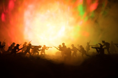 Military silhouettes fighting scene on war fog sky background