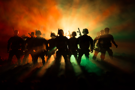 War Concept. Military silhouettes fighting scene on war fog sky background