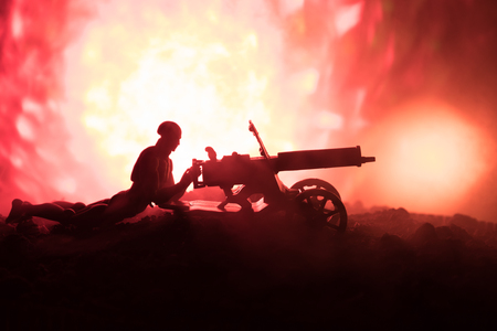 Man with Machine gun at night, fire explosion background Stock Photo