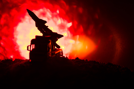 Rocket launch with fire clouds. Battle scene with rocket Missiles with Warhead Aimed at Gloomy Sky at night.
