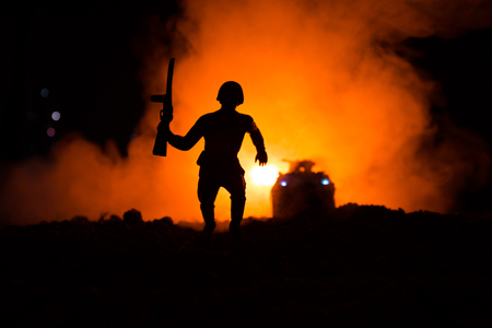 Military soldier silhouette with gun.
