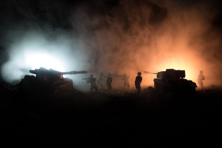 War Concept. Military silhouettes fighting scene on war fog sky background, World War Soldiers Silhouettes Below Cloudy Skyline At night. Attack scene. Armored vehicles. Tanks battle. Decoration Archivio Fotografico