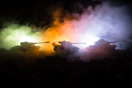 War Concept. Military silhouettes fighting scene on war fog sky background, World War Soldiers Silhouettes Below Cloudy Skyline At night. Attack scene. Armored vehicles. Tanks battle. Decoration Stok Fotoğraf