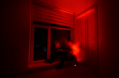 Horror man in window scary scene halloween concept Blurred silhouette of ghost. Horror theme. Selective focus