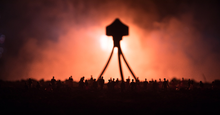 Blurred silhouette of giant monster prepare attack crowd during night. Selective focus. Stockfoto