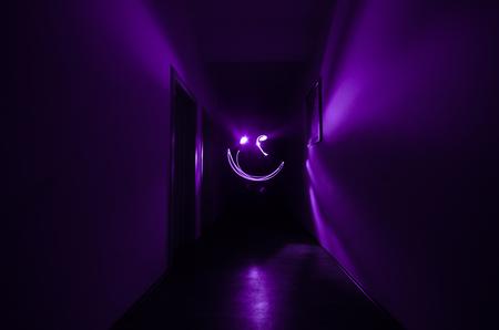 Dark corridor with cabinet doors and freezelight figures on it. Horror Concept.
