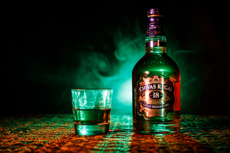 BAKU, AZERBAIJAN - MARCH 25, 2018: Blended from whiskies matured for at least 18 years, Chivas Regal 18 Gold Signature is a blended Scotch whisky produced by Chivas Brothers in Keith, Scotland. Imagens - 104861036