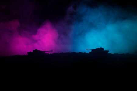 War Concept. Military silhouettes fighting scene on war fog sky background, World War German Tanks Silhouettes Below Cloudy Skyline At night.