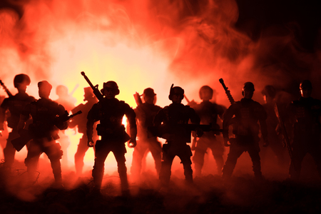 Anti-riot police give signal to be ready. Government power concept. Police in action. Smoke on a dark background with lights. Blue red flashing sirens. Dictatorship power. Selective focus