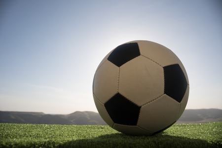 soccer ball on soccer field. Football on green grass. Sunny background. Selective focus 스톡 콘텐츠