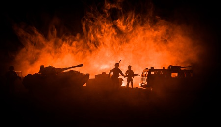 War Concept. Military silhouettes fighting scene on war fog sky background, Fighting silhouettes Below Cloudy Skyline At night. Battle scene. Army jeep vehicle with soldiers. army jeep Stock Photo